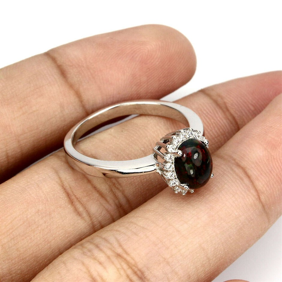 Rainbow Lustre Black Oval Cabochon Opal Ring. Size 'P'