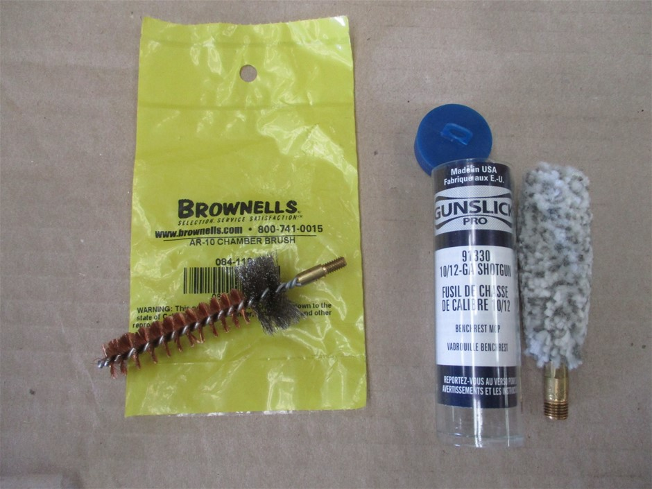 Carton of Gunslick and Brownells Gun Cleaning Brushes and Jags