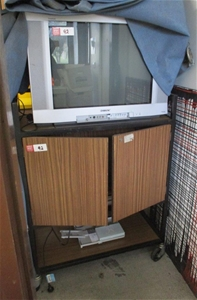 TV Trolley/Cabinet With TV and Assorted