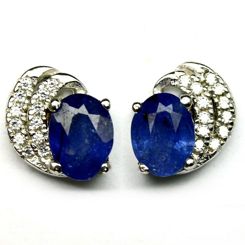 Deep Blue Oval Cut Sapphire Earrings.