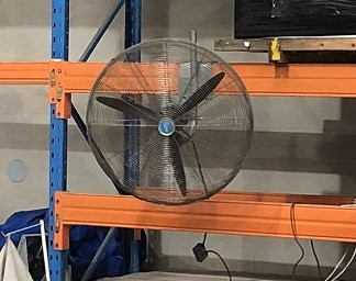 Factory fan attached to racking