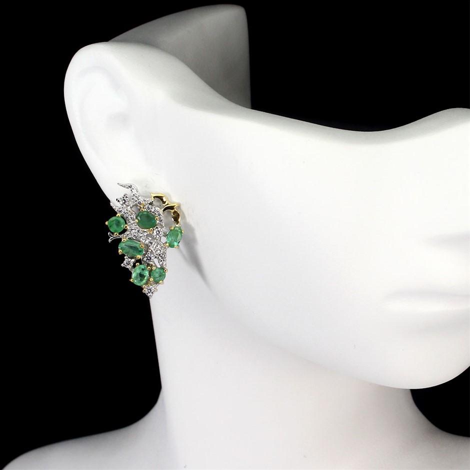Genuine emerald Huggie earrings.