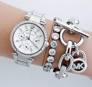 Never worn Michael Kors Couture Parker chrono. diamante watch.
