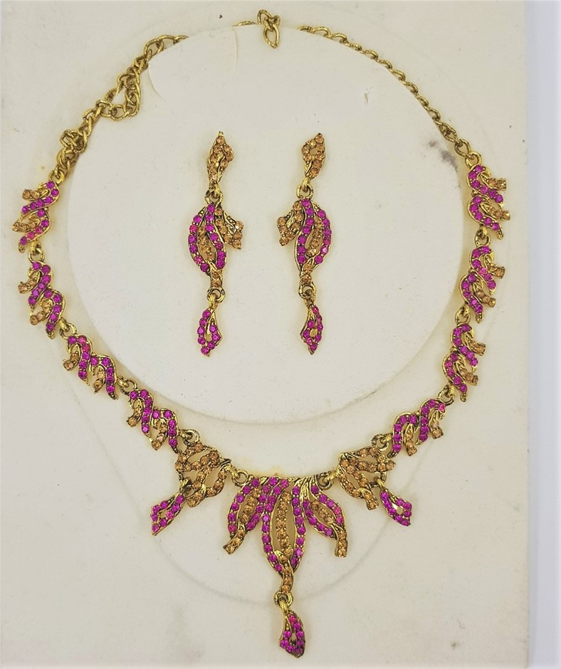Gold Tone Fuchsia & Gold Crystal Necklace/Earring Set.