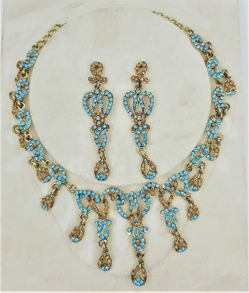 Gold Tone Aqua & Gold Crystal Necklace/Earring Set.