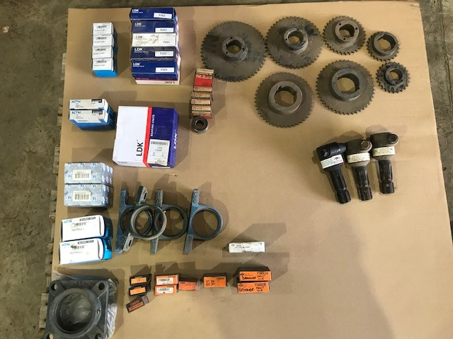 Pallet of Assorted Bearings, Chain Drive Sprockets, Drive Shafts, etc.
