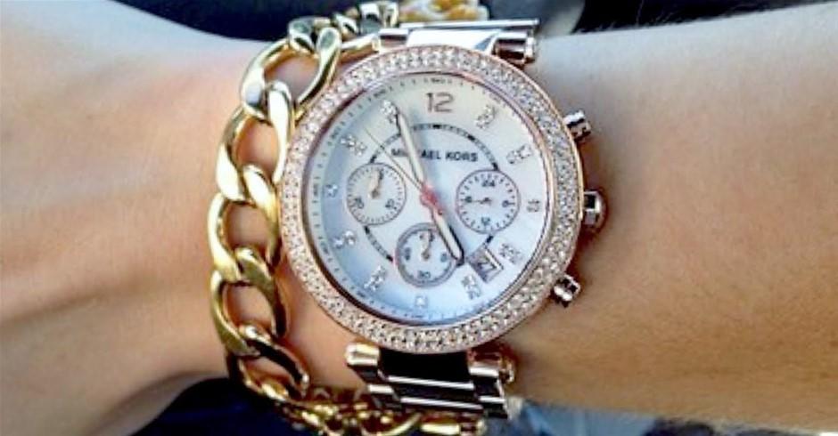 New Michael Kors Couture gold plated dual time chronograph watch.