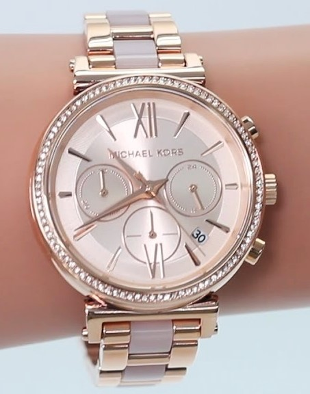 Ladies new Michael Kors Couture NY gold plated stunning chrono watch.