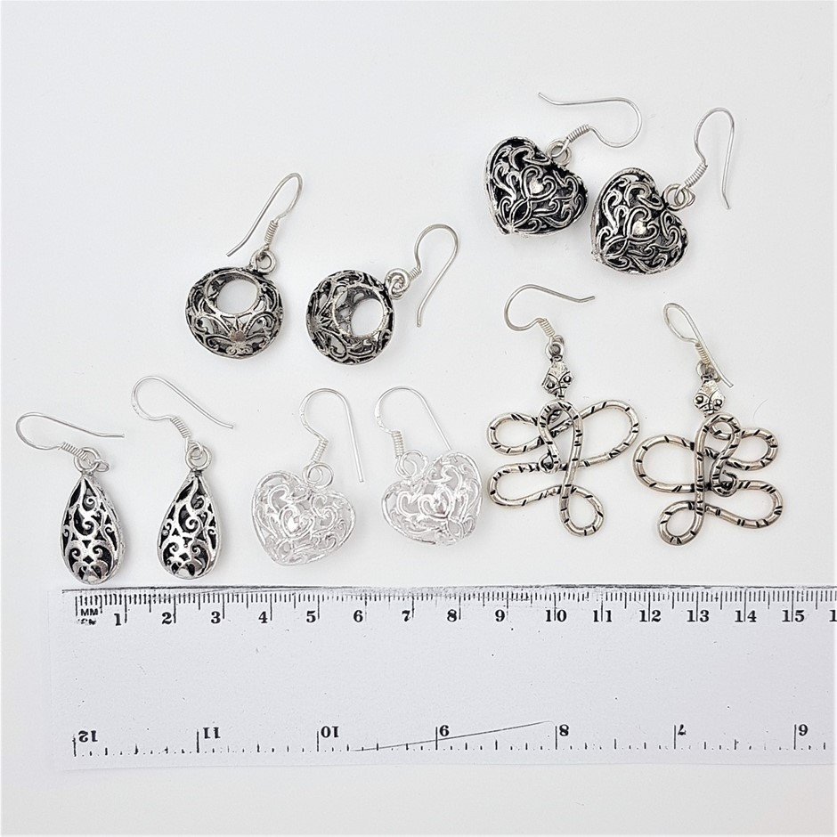 Collection Of 5 Pairs Silver Tone Earrings.