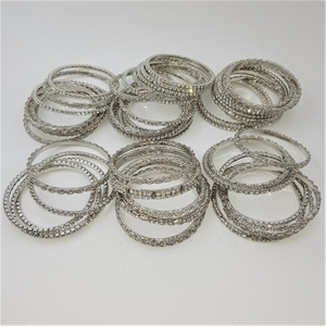Collection Of 50 White Crystal Bangles.