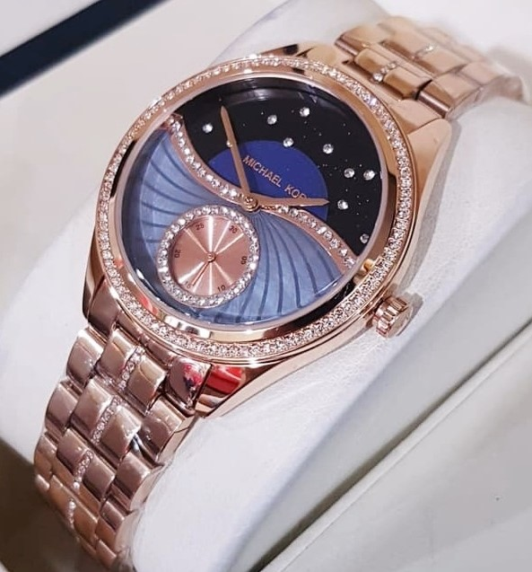 Ladies new Michael Kors Lauryn beautiful watch with amazing Sunray dial.