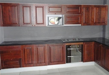 J shaped kitchen cabinets with Rich Oak Doors