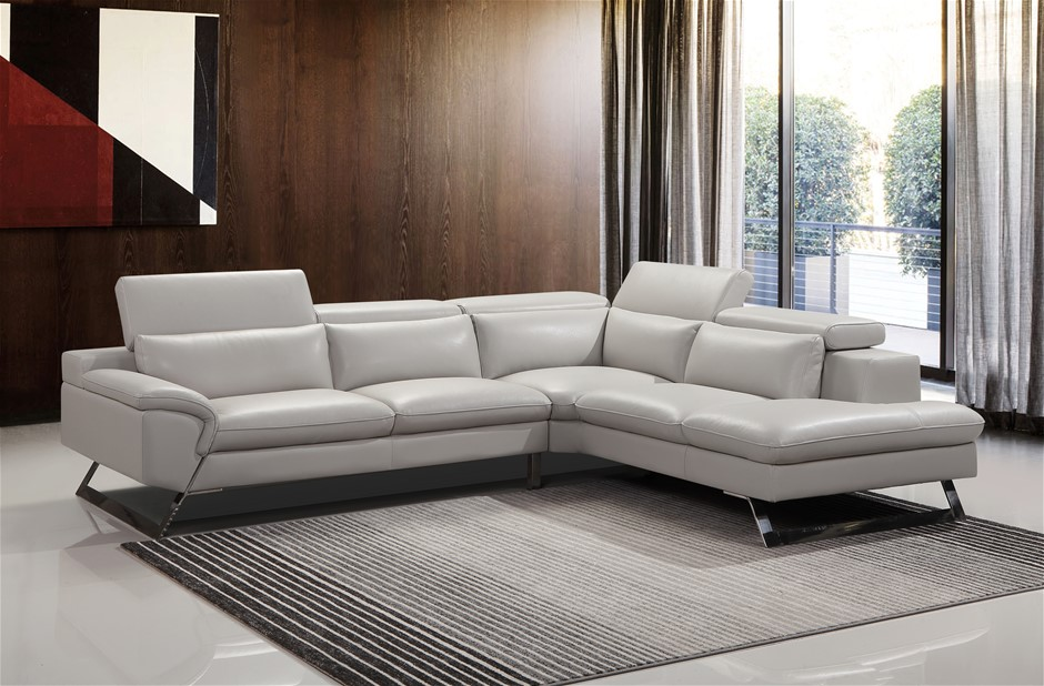 This stylish cream sofa is fully upholstered in Finest White Leatherette