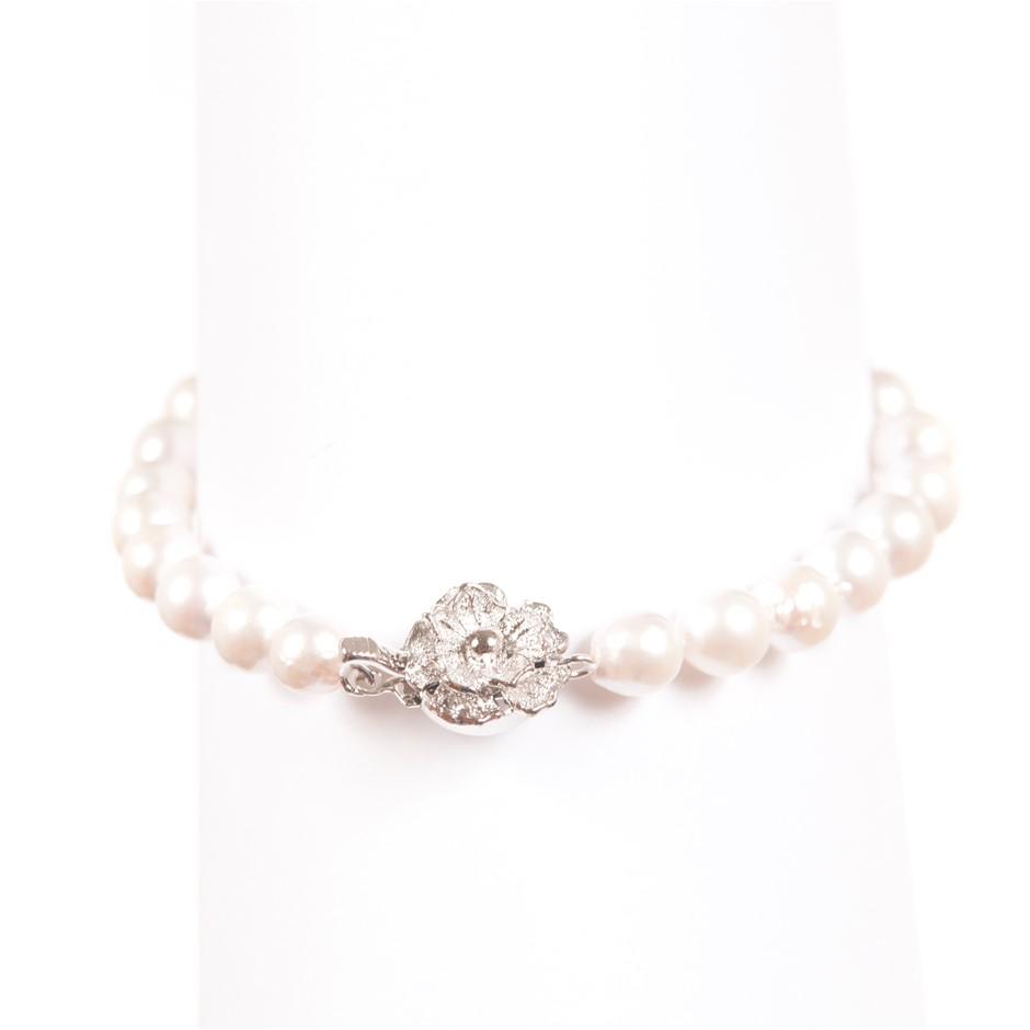 Lovely Single Strand Bracelet of Japanese Near Round Akoya Pearls.