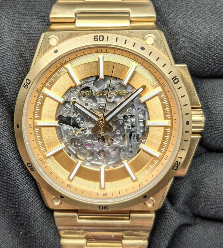 Mens new Michael Kors Couture NY automatic gold plated watch.