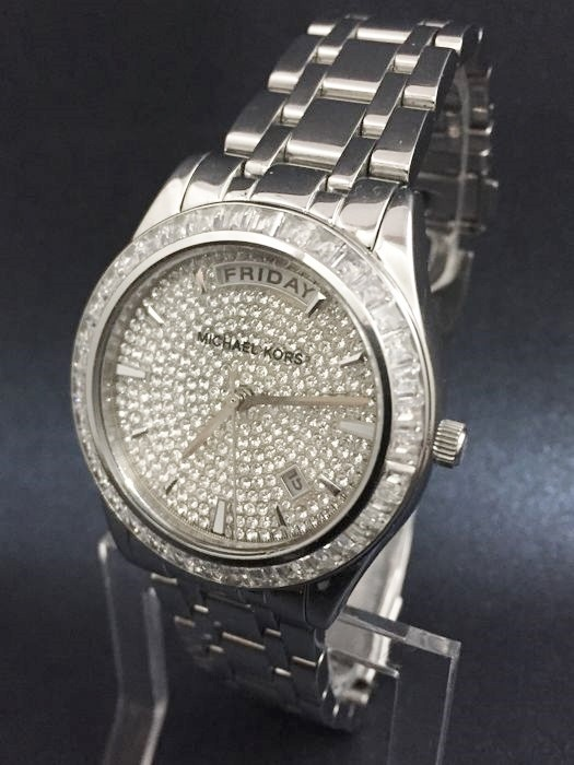 Ladies new beautiful & classy Michael Kors Couture NY pave watch.